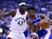 Philadelphia 76ers guard Jimmy Butler goes to the basket against Pascal Siakam against the Toronto Raptors