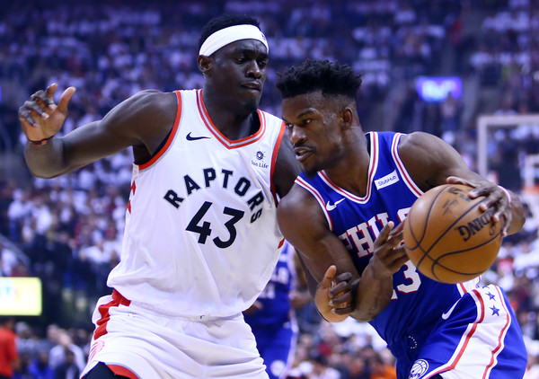 Philadelphia 76ers guard Jimmy Butler goes to the basket against Pascal Siakam against the Toronto Raptors