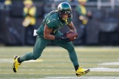 Former Oregon Ducks player Keanon Lowe rushes the ball against the Colorado Buffaloes