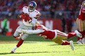 Former San Francisco 49ers linebacker Reuben Foster attempts to tackle Shane Vereen against the New York Giants