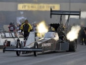 Top Fuel Dragster pilot Mike Salinas racing on Saturday at the Route 66 NHRA Nationals