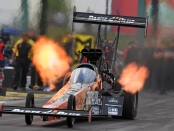Top Fuel Dragster pilot Clay Millican racing on Monday at the Menards NHRA Heartland Nationals presented by Minties