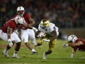 Notre Dame Fighting Irish running back Dexter Williams carries the ball against the Stanford Cardinal