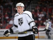 Former Los Angeles Kings defenseman Dion Phaneuf awaits a face-off during the third period against the Arizona Coyotes