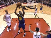 Golden State Warriors center Kevon Looney dunks the ball in Game 1 of the NBA Finals against the Toronto Raptors