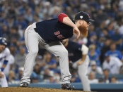 Former Boston Red Sox pitcher Craig Kimbrel prepares to make a pitch against the Los Angeles Dodgers in the 2018 World Series