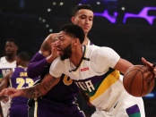 Former New Orleans Pelicans center Anthony Davis drives to the basket against Kyle Kuzma against the Los Angeles Lakers