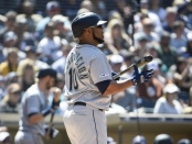 Former Seattle Mariners First Baseman and Designated Hitter Edwin Encarnación walks back to the dugout after striking out against the San Diego Padres
