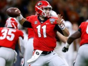 Georgia Bulldogs quarterback Jake Fromm attempts a pass against the Texas Longhorns in the Allstate Sugar Bowl