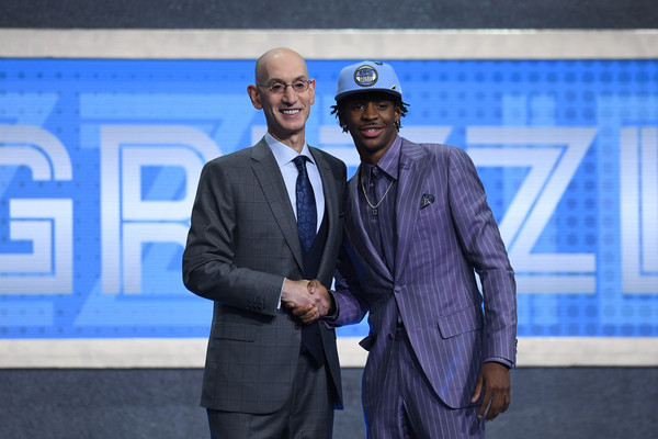 Draft prospect Ja Morant poses with NBA Commissioner Adam Silver after being drafted in the 2019 NBA Draft