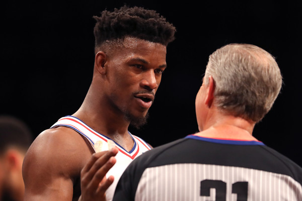 Former Philadelphia 76ers guard Jimmy Butler speaks with a referee in the 2019 NBA playoffs against the Brooklyn Nets