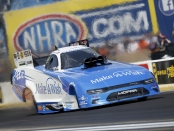 Funny Car pilot Tommy Johnson Jr. racing on Sunday at the Route 66 NHRA Nationals