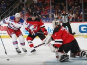 Former New York Rangers forward Kevin Hayes attempts to score while being defended by Will Butcher and Keith Kinkaid against the New Jersey Devils