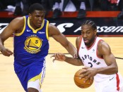 Golden State Warriors center Kevon Looney defending Kawhi Leonard against the Toronto Raptors in Game 2 of the NBA Finals