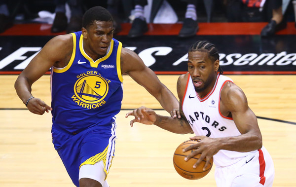 Golden State Warriors center Kevon Looney defending Kawhi Leonard against the Toronto Raptors in Game 2 of the NBA Finals