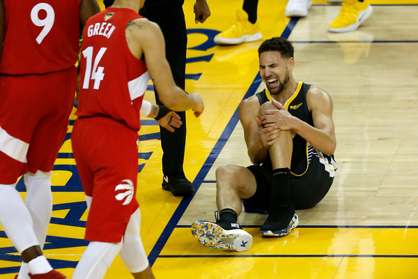 Golden State Warriors guard Klay Thompson reacts after being injured against the Toronto Raptors in the 2019 NBA Finals