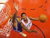 Toronto Raptors guard Kyle Lowry attempts to score while being defended by DeMarcus Cousins against the Golden State Warriors