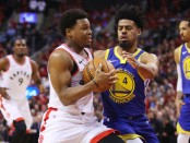 Toronto Raptors guard Kyle Lowry is defended by Quin Cook against the Golden State Warriors