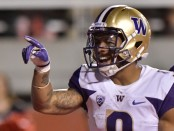 Former Washington Huskies running back Myles Gaskin gestures after scoring a touchdown against the Utah Utes
