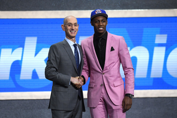 Draft prospect R.J. Barrett poses with the NBA Commissioner Adam Silver after being drafted at the 2019 NBA Draft