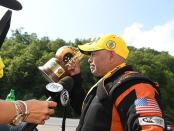 Top Fuel Dragster pilot Mike Salinas after winning the Wally on Sunday at the NHRA Thunder Valley Nationals