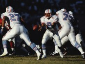 Tennessee Titans greats Steve McNair passes the ball to Eddie George against the Arizona Cardinals