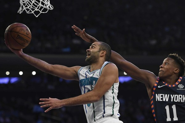 Former Charlotte Hornets guard Tony Parker attempts a layup against the New York Knicks