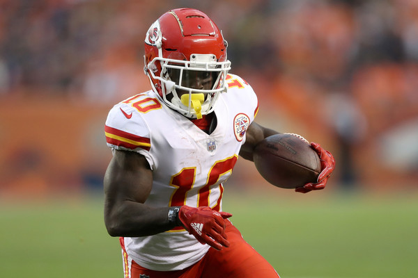 Kansas City Chiefs wide receiver Tyreek Hill carries the ball against the Denver Broncos