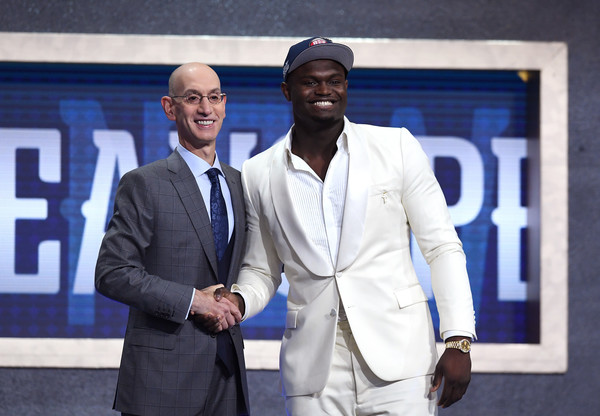 Draft prospect Zion Williamson poses with NBA Commissioner Adam Silver after being drafted by the New Orleans Pelicans at the 2019 NBA Draft