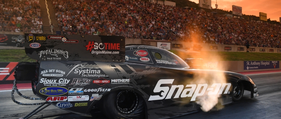 Funny Car pilot Cruz Pedregon racing on Friday at the Dodge Mile-High Nationals Presented by Pennzoil
