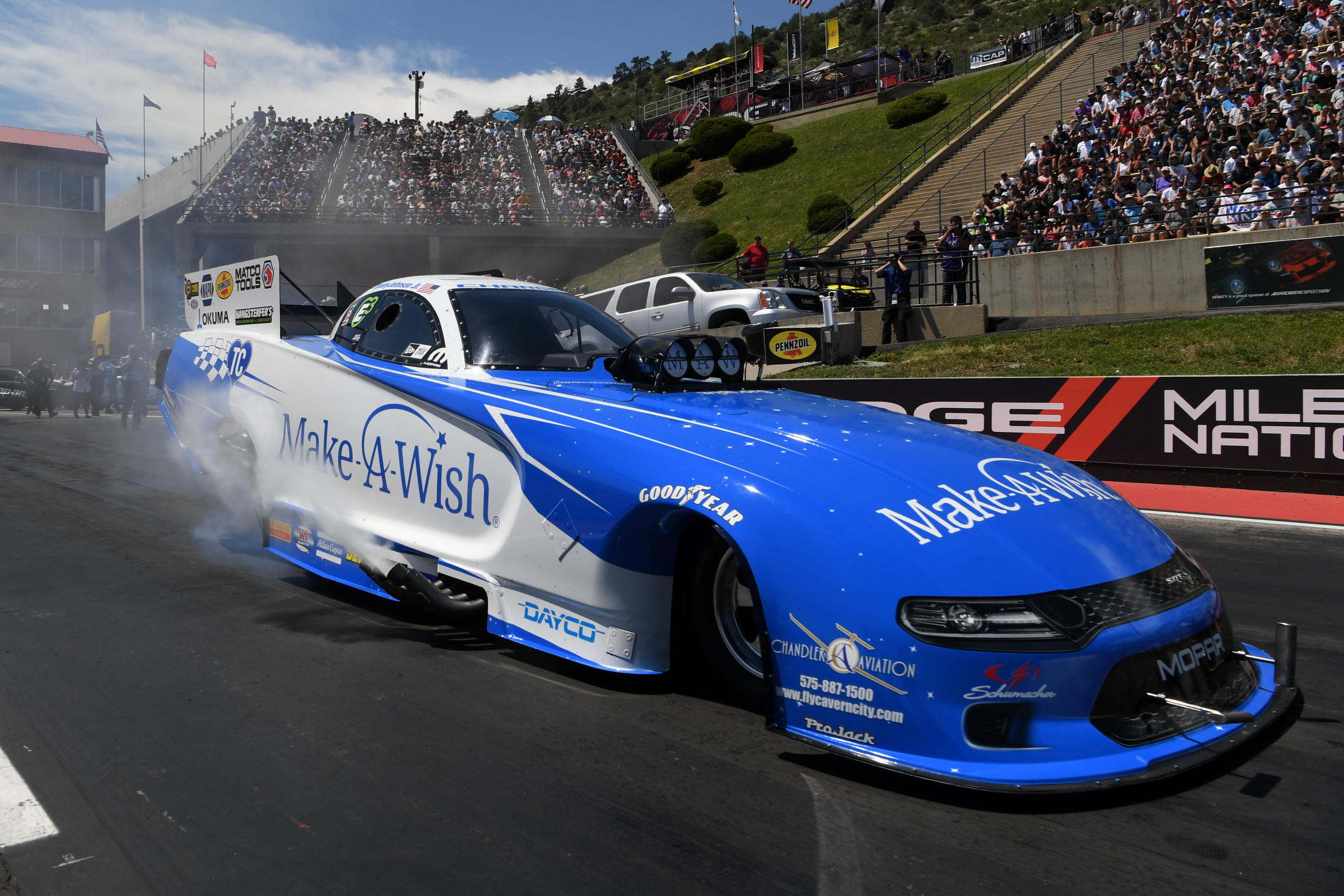 Funny Car pilot Tommy Johnson Jr. racing on Sunday at the 2019 Dodge Mile-High NHRA Nationals