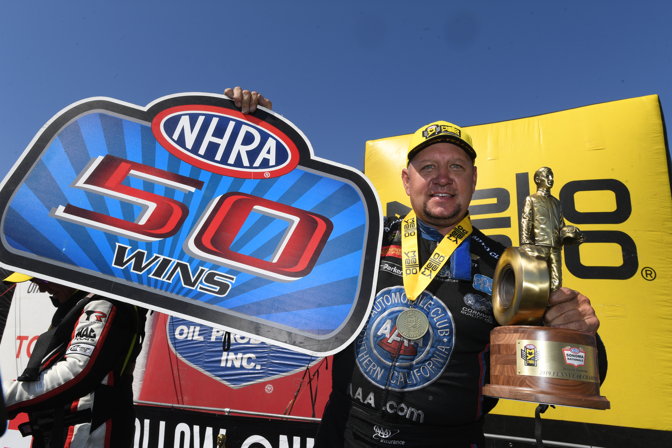 Funny Car pilot Robert Hight with the 50 wins sign after winning the 2019 Toyota NHRA Sonoma Nationals