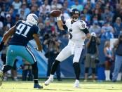 Former Tennessee Titans linebacker Derrick Morgan pressures Baltimore Ravens quarterback Joe Flacco