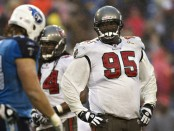 Former Tampa Bay Buccaneers defensive lineman Albert Haynesworth looks over the offense against the Tennessee Titans