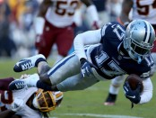 Former Dallas Cowboys wide receiver Allen Hurns is tackled by Josh Norman against the Washington Redskins