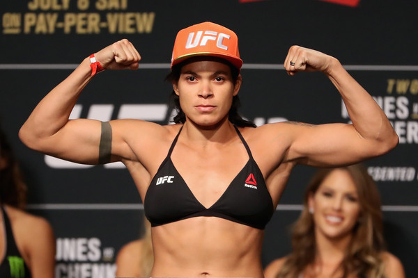 MMA fighter Amanda Nunes poses on the scale during her UFC 213 weigh-in