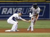 Tampa Bay Rays second baseman Brandon Lowe catches Andrew McCutchen in an attempt to steal second base against the New York Yankees