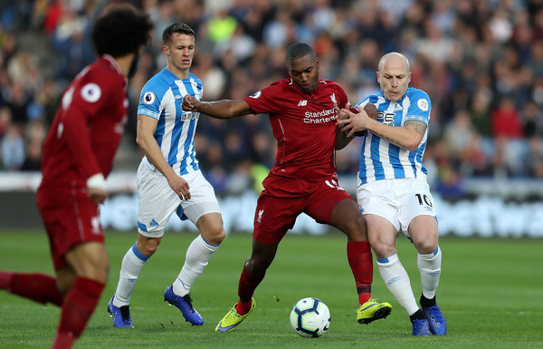 Former Liverpool striker Daniel Sturridge is tackled by Aaron Mooney against Huddersfield Town