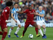 Former Liverpool striker Daniel Sturridge is tackled by Aaron Mooney against Huddersfield Town