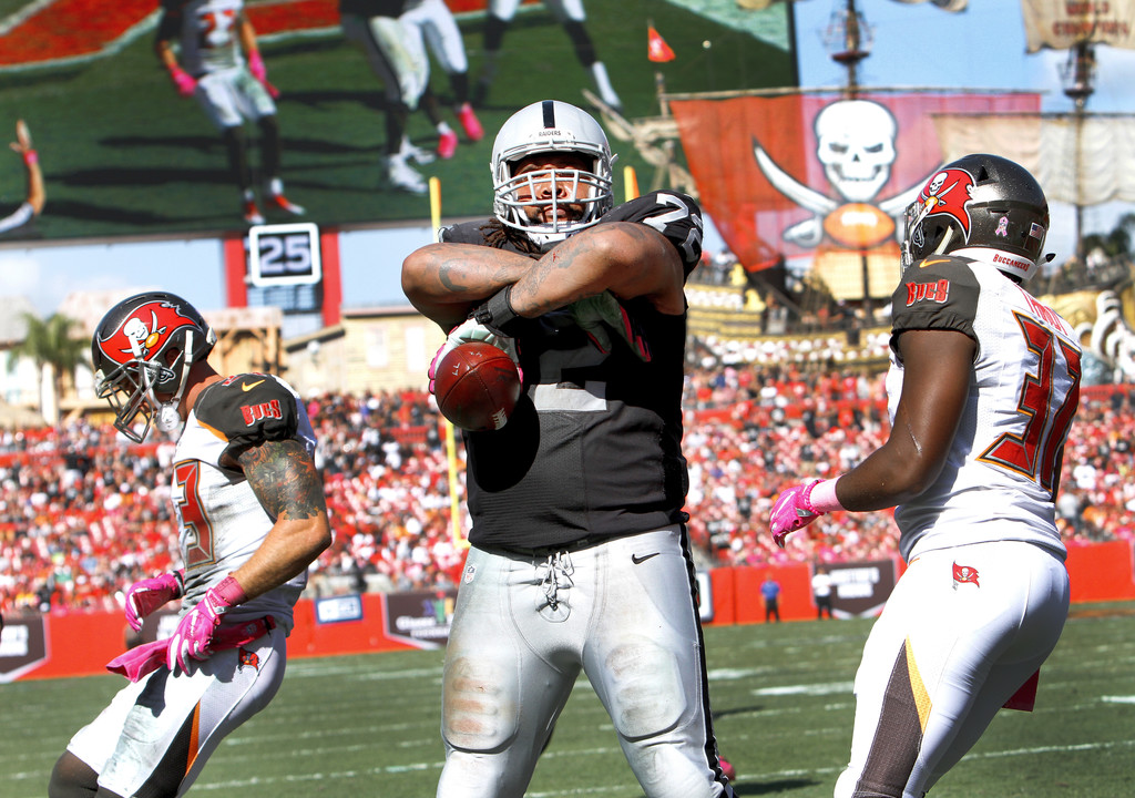 Former Oakland Raiders offensive lineman Donald Penn celebrates a touchdown against the Tampa Bay Buccaneers