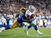 Dallas Cowboys running back Ezekiel Elliott is tackled by Cory Littleton against the Los Angeles Rams in the 2019 NFC Divisional Round playoff game