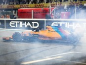 Driver Fernando Alonso performs donuts on the pit straight during the Abu Dhabi Formula One Grand Prix
