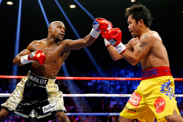Boxers Floyd Mayweather Jr. throws a left at Manny Pacquiao in their welterweight unification fight