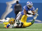 Former Detroit Lions wide receiver Golden Tate makes a reception, as Oren Burks attempts to tackle him against the Green Bay Packers