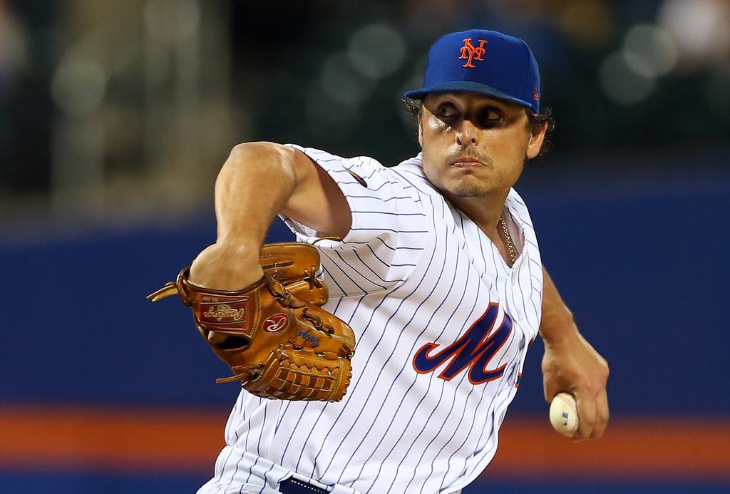 Former New York Mets pitcher Jason Vargas delivers a pitch against the Atlanta Braves