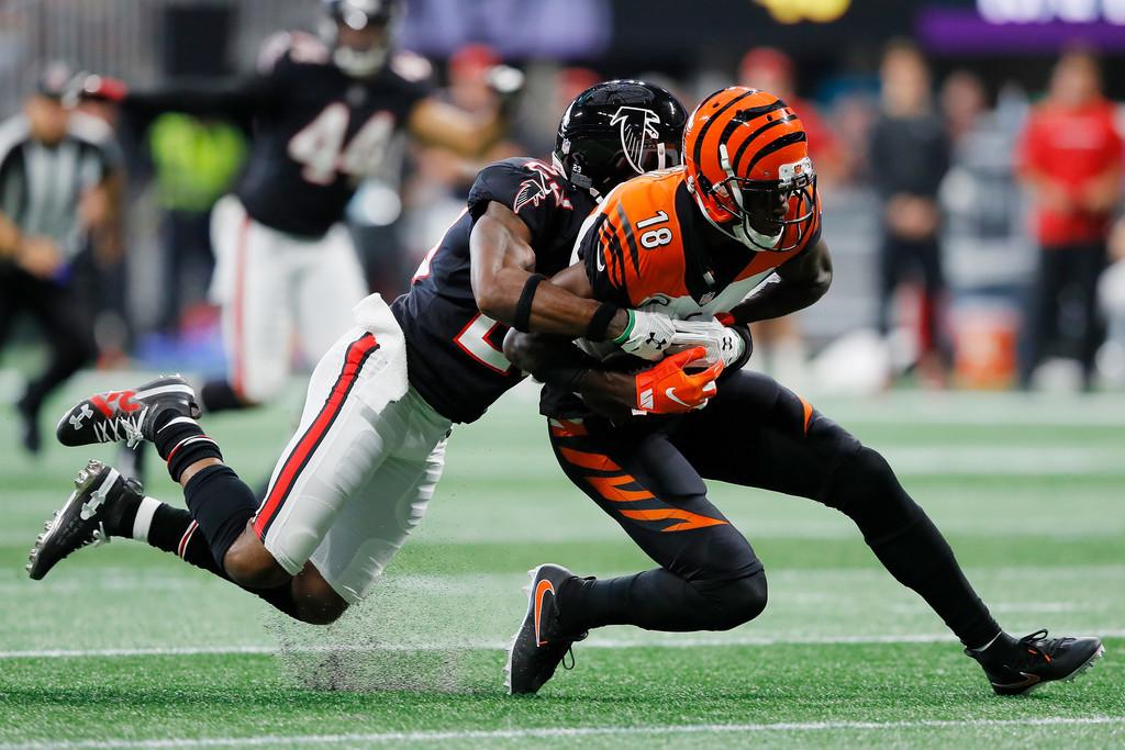 Cincinnati Bengals wide receiver A.J. Green is tackled by Robert Alford against the Atlanta Falcons