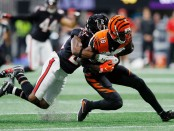 Cincinnati Bengals wide receiver A.J. Green is tackled by Robert Alford against the Atlanta Falcons