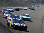 Driver Jimmie Johnson leads a pack of cars during the Monster Energy NASCAR Cup Series Gander 400