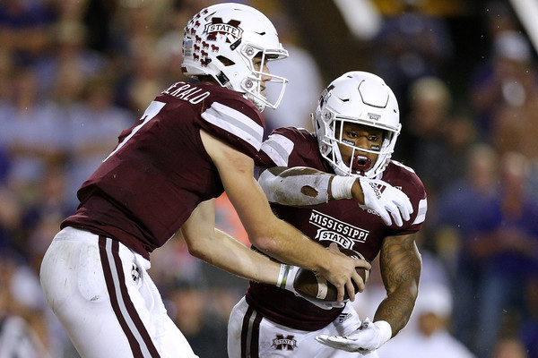 Former Mississippi State Bulldogs quarterback Nick Fitzgerald hands the ball off to Kylin Hill against the LSU Tigers
