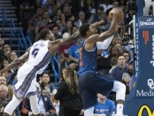 Former Oklahoma City Thunder forward Paul George drives to the basket against the Sacramento Kings